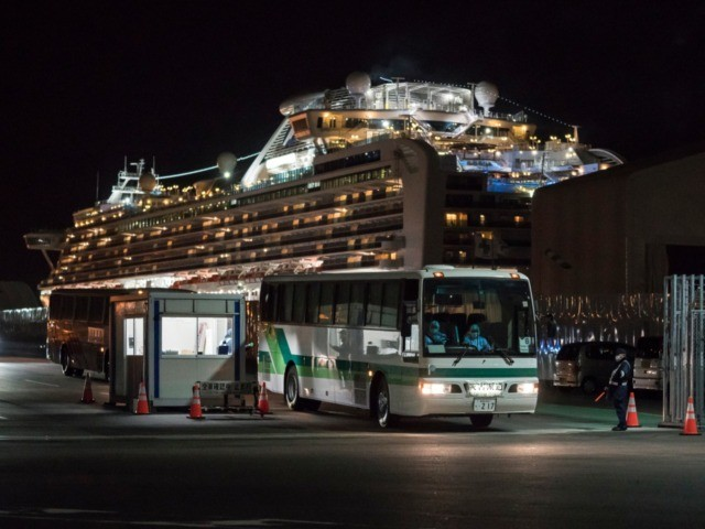 YOKOHAMA, JAPAN - FEBRUARY 20: A bus carrying passengers who will take a government charter flight from the quarantined Diamond Princess cruise ship drive at the Daikoku Pier on February 20, 2020 in Yokohama, Japan. Passengers who have tested negative for the coronavirus (COVID-19) have been disembarking the cruise ship …