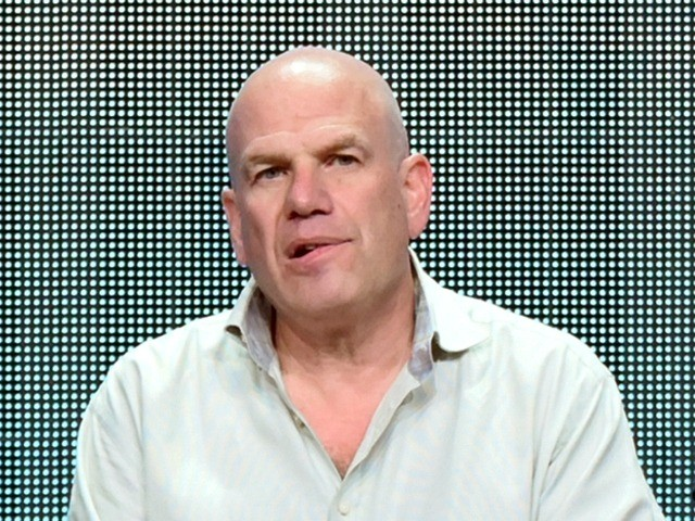 """FILE - In this July 30, 2015 file photo, producer David Simon appears during the """"Show Me a Hero"""" panel at the HBO 2015 Summer TCA Tour in Beverly Hills, Calif. Simon and Fox News Channel host Sean Hannity are tossing vulgarities at each other on social media. Simon, who …"""