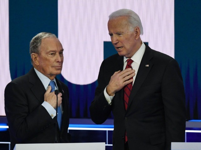 Democratic presidential hopefuls Former New York Mayor Mike Bloomberg (L) and Former Vice President Joe Biden (R) speak during a break in the ninth Democratic primary debate of the 2020 presidential campaign season co-hosted by NBC News, MSNBC, Noticias Telemundo and The Nevada Independent at the Paris Theater in Las …