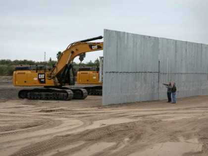 MISSION, TEXAS - DECEMBER 11: A construction crew works on a section of privately built border wall on December 11, 2019 near Mission, Texas. The hardline immigration group We Build The Wall is funding the construction of the wall on private land along a stretch of the Rio Grande, which …