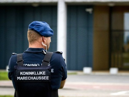 A police officer stands outside the extra secure court in Schiphol, where the hearing in the Marengo criminal case takes place on September 24, 2019. - The case revolves around a series of liquidations commissioned by the fugitive Ridouan Taghi. Last week Derk Wiersum, lawyer of crown witness Nabil B, …