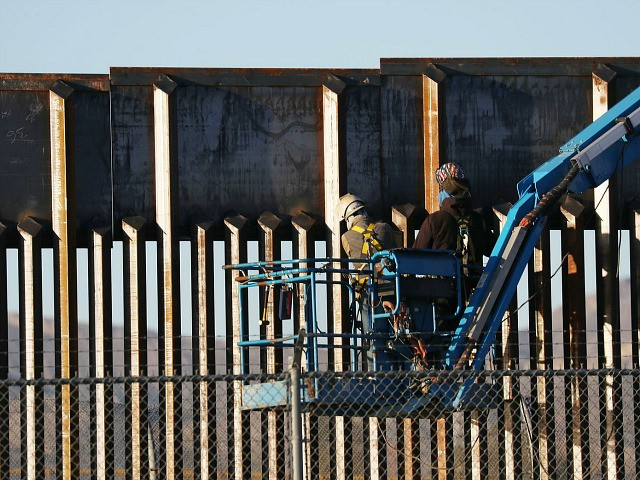 EL PASO, TEXAS - FEBRUARY 12: People work on the U.S./ Mexican border wall on February 12, 2019 in El Paso, Texas. U.S. President Donald Trump visited the border city yesterday as he continues to campaign for more wall to be built along the border. Democrats in Congress are asking …