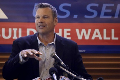 FILE- In this July 8, 2019 file photo, former Kansas Secretary of State Kris Kobach addresses the crowd as he announces his candidacy for the Republican nomination for the U.S. Senate in Leavenworth, Kan. Secretary of State Mike Pompeo said Tuesday, Jan. 7, 2020, that he'll remain in his post …