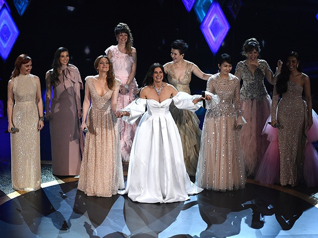"Idina Menzel, center, performs with international voice actresses that play Elsa in the movie ""Frozen II"" at the Oscars on Sunday, Feb. 9, 2020, at the Dolby Theatre in Los Angeles. (AP Photo/Chris Pizzello)"