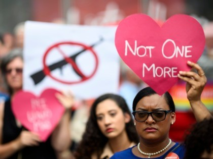 TOPSHOT - Protestors take part in a rally of Moms against gun violence and calling for Federal Background Checks on August 18, 2019 in New York City. (Photo by Johannes EISELE / AFP) (Photo by JOHANNES EISELE/AFP via Getty Images)