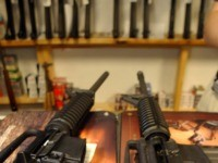 DENVER - SEPTEMBER 13: Two Colt AR-15's, both now legal, sit on the counter of Dave's Guns September 13, 2004 in Denver, Colorado. The weapon on the right has a bayonet mount, flash suppressor and a collapsible stock, the gun on the left does not. Between 1994 and September 13, …