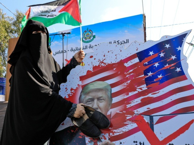 A Palestinian woman slams with her shoes a portrait of US President Donald Trump during a demonstration by women supporters of the Hamas movement, against the US Middle East peace plan, in Gaza City on February 5, 2020. (Photo by Emmanuel DUNAND / AFP) (Photo by EMMANUEL DUNAND/AFP via Getty …