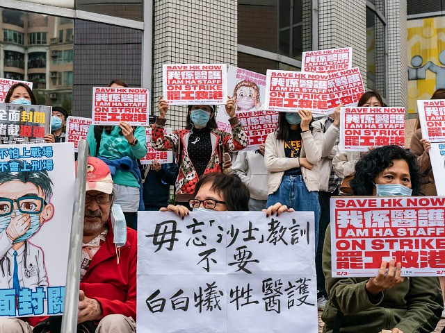 HONG KONG, CHINA - FEBRUARY 07: Members of the Hospital Authority Employees Alliance (HAEA) hold placards during a strike at the Hospital Authority building to demand the government shut the city's border with China to reduce the spread of the coronavirus on February 7, 2020 in Hong Kong, China. Hong …