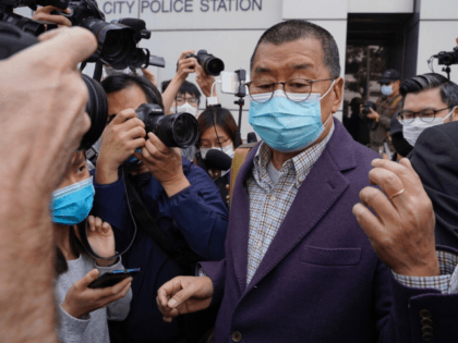 Founder of Hong Kong's Apple Daily newspaper, Jimmy Lai, walks out from a police station after being bailed out in Hong Kong, Friday, Feb. 28, 2020. Hong Kong's Apple Daily newspaper says the outspoken head of its publishing group, Lai, has been held by police over his participation in a …