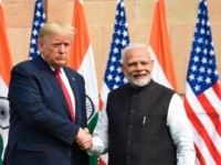 India's Prime Minister Narendra Modi (R) shakes hands with US President Donald Trump before a meeting at Hyderabad House in New Delhi on February 25, 2020. (Photo by Prakash SINGH / AFP) (Photo by PRAKASH SINGH/AFP via Getty Images)
