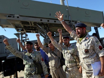 Iranian navy personnel celebrate after successfully launching a Ghader missile from the Jask port area on the shores of the Sea of Oman during a drill, Tuesday, Jan. 1, 2013. Iran says it has tested advanced anti-ship missiles in the final day of a naval drill near the strategic Strait …