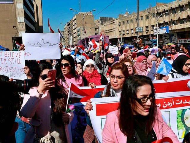 Women take part in a protest in Tahrir Square, Baghdad, Iraq, Thursday, Feb. 13, 2020. Hundreds of Iraqi women took to the streets of central Baghdad and southern Iraq on Thursday in defiance of a radical cleric's calls for gender segregation in anti-government protest sites. Iraqis began protesting on Oct. …