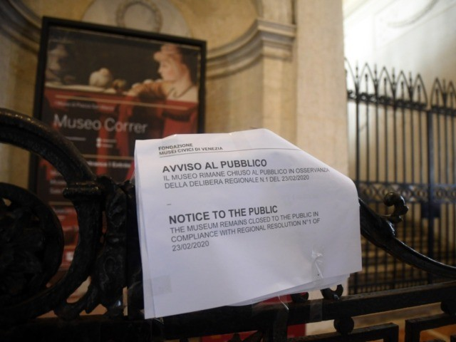A picture taken in Venice on February 24, 2020 shows a sign at the entrance of the Correr museum informing about the closure amid fears over the spread of the COVID-19. - Under the shadow of a new coronavirus outbreak, Italy took drastic containment steps as worldwide fears over the …