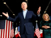 Democratic presidential candidate former Vice President Joe Biden at a caucus night campaign rally on Monday, Feb. 3, 2020, in Des Moines, Iowa, with Jill Biden. (AP Photo/John Locher)