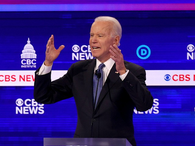 CHARLESTON, SOUTH CAROLINA - FEBRUARY 25: Democratic presidential candidate former Vice President Joe Biden speaks as Sen. Bernie Sanders (I-VT) (L) looks on during the Democratic presidential primary debate at the Charleston Gaillard Center on February 25, 2020 in Charleston, South Carolina. Seven candidates qualified for the debate, hosted by …
