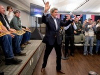Former Secretary of State John Kerry arrives at a campaign stop for Democratic presidential candidate former Vice President Joe Biden at the South Slope Community Center, Saturday, Feb. 1, 2020, in North Liberty, Iowa. (AP Photo/Andrew Harnik)