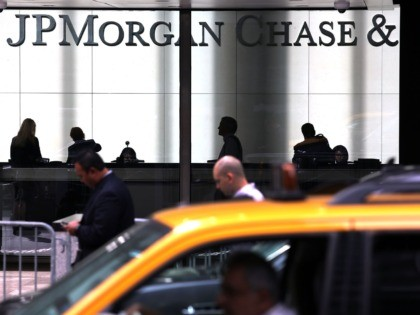 NEW YORK, NY - OCTOBER 02: People pass a sign for JPMorgan Chase & Co. at it's headquarters in Manhattan on October 2, 2012 in New York City. New York Attorney General Eric Schneiderman has filed a civil lawsuit against JPMorgan Chase alleging widespread fraud in the way that mortgages …
