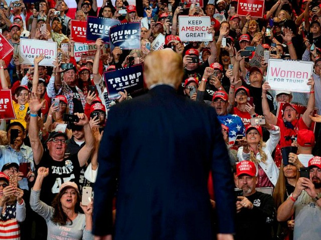 Supporters cheer as US President Donald Trump arrives to deliver remarks at a Keep America Great rally in Las Vegas, Nevada, on February 21, 2020. (Photo by JIM WATSON / AFP) (Photo by JIM WATSON/AFP via Getty Images)