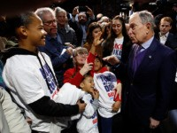 FILE - In this Feb. 3, 2020, photo, Democratic presidential candidate and former New York City Mayor Michael Bloomberg, right, talks with supporters during a campaign stop in Sacramento, Calif. (AP Photo/Rich Pedroncelli)