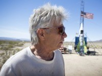 "FILE - In this March 6, 2018, file photo, ""Mad"" Mike Hughes reacts after the decision to scrub another launch attempt of his rocket near Amboy, Calif. The self-styled daredevil died Saturday, Feb. 22, 2020, after a rocket in which he launched himself crashed into the ground, a colleague and …"