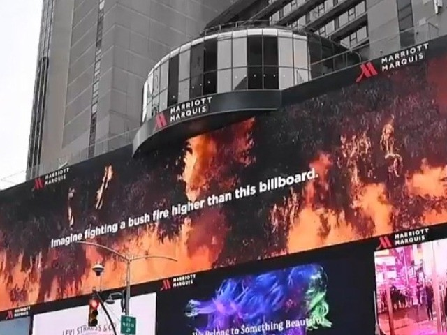 Volunteer U.S. firefighters and their compatriots from around the world have been publicly thanked by Australia for their help over the past four months, courtesy of a billboard and video display in New York's Times Square.