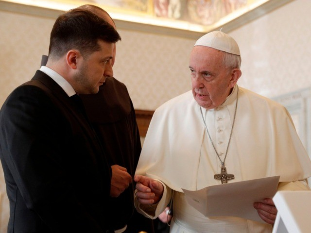 Pope Francis exchanges gift with Ukrainian President Volodymyr Zelensky (L) during a private audience at the Vatican on February 8, 2020. (Photo by Gregorio Borgia / POOL / AFP) (Photo by GREGORIO BORGIA/POOL/AFP via Getty Images)