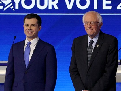 MANCHESTER, NEW HAMPSHIRE - FEBRUARY 07: (L-R) Democratic presidential candidates former South Bend, Indiana Mayor Pete Buttigieg, Sen. Bernie Sanders (I-VT), Sen. Elizabeth Warren (D-MA), and former Vice President Joe Biden, arrive on stage for the start of a Democratic presidential primary debate in the Sullivan Arena at St. Anselm …