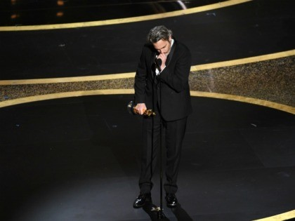 HOLLYWOOD, CALIFORNIA - FEBRUARY 09: Joaquin Phoenix accepts the Actor In A Leading Role award for 'Joker' onstage during the 92nd Annual Academy Awards at Dolby Theatre on February 09, 2020 in Hollywood, California. (Photo by Kevin Winter/Getty Images)