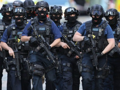 LONDON, ENGLAND - JUNE 04: Counter terrorism officers march near the scene of last night's London Bridge terrorist attack on June 4, 2017 in London, England. Police continue to cordon off an area after responding to terrorist attacks on London Bridge and Borough Market where 6 people were killed and …