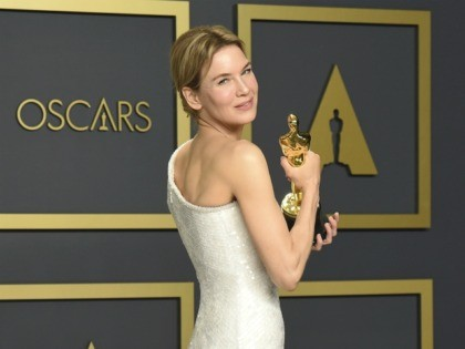 "Renee Zellweger, winner of the award for best performance by an actress in a leading role for ""Judy"", poses in the press room at the Oscars on Sunday, Feb. 9, 2020, at the Dolby Theatre in Los Angeles. (Photo by Jordan Strauss/Invision/AP)"