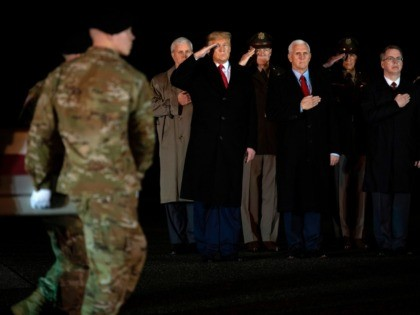US President Donald Trump (L) and Vice President Mike Pence (C) observe the dignified transfer of two US soldiers, killed in Afghanistan, at Dover Air Force Base in Dover, Delaware, on February 10, 2020 with . - The two soldiers have been identified as Sgt. 1st Class Javier Jaguar Gutierrez, …