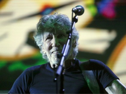 Former member of Pink Floyd, British singer and songwriter Roger Waters performs during his concert of the Us+Them tour in Rome's Circus Maximus, Saturday, July 14, 2018. (AP Photo/Gregorio Borgia)