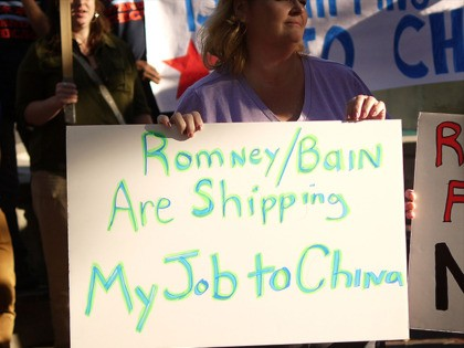 EVANSTON, IL - AUGUST 21: Protesters outside the offices of Bain Capital demonstrate against the company on August 21, 2012 in Evanston, Illinois. The demonstrators are angry with Bain Capital's plans to move to China 165 jobs from the Sensata Technologies plant in Freeport, Illinois. Workers from the plant delivered …