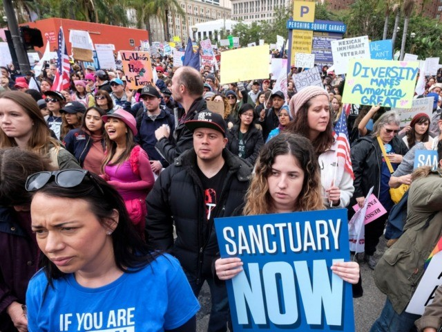 """FILE - In this Feb. 18, 2017, file photo, thousands of people take part in the """"Free the People Immigration March,"""" to protest actions taken by President Donald Trump and his administration, in Los Angeles. A federal appeals court has given the Trump administration a rare legal win in its …"""