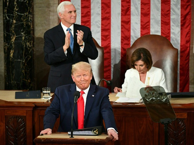 US Vice President Mike Pence and Speaker of the House Nancy Pelosi welcome US President Donald Trump as he arrives for his State of the Union address at the US Capitol in Washington, DC, on February 4, 2020. (Photo by MANDEL NGAN / AFP) (Photo by MANDEL NGAN/AFP via Getty …