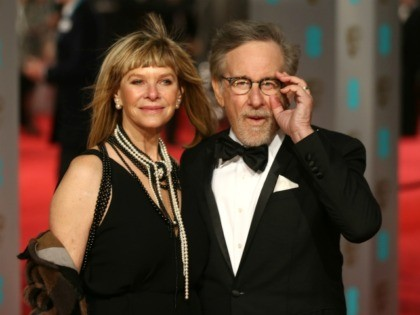 US director Steven Spielberg (R) and wife Kate Capshaw pose on arrival for the BAFTA British Academy Film Awards at the Royal Opera House in London on February 14, 2016. AFP PHOTO / JUSTIN TALLIS / AFP / JUSTIN TALLIS (Photo credit should read JUSTIN TALLIS/AFP via Getty Images)