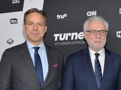 NEW YORK, NY - MAY 18: (L-R) Journalists Jake Tapper, Wolf Blitzer, and Anderson Cooper attend the Turner Upfront 2016 at Nick & Stef's Steakhouse on May 18, 2016 in New York City. (Photo by Slaven Vlasic/Getty Images)