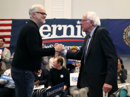 HANOVER, NEW HAMPSHIRE - FEBRUARY 09: Actor Tim Robbins (L) shakes hands with Democratic presidential candidate Sen. Bernie Sanders (I-VT) as he introduces him to speak during a Town Hall at the Hanover Inn Dartmouth on February 09, 2020 in Hanover, New Hampshire. Mr. Sanders is campaigning before the primary …