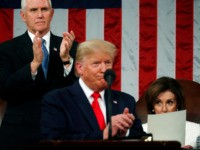 WASHINGTON, DC - FEBRUARY 04: U.S. Vice President Mike Pence applauds as House Speaker Nancy Pelosi remains seated during U.S. President Donald Trump's State of the Union address in the House chamber on February 4, 2020 in Washington, DC. Trump is delivering his third State of the Union address on …
