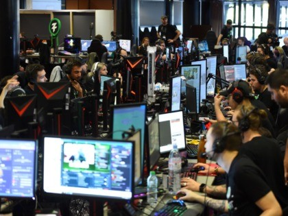 "Gamers take part during the ""Zevent"", the marathon of video games for charity with 54 hours of live gaming with 50 streamers in Montpellier on September 20, 2019. - Headsets harnessed and reserves of energy drinks to last for two days and three nights, 54 French eSport stars have startedthe …"