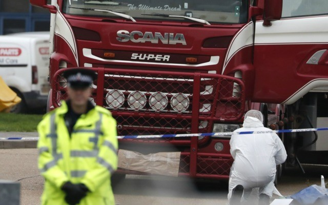 In this file photo dated Wednesday Oct. 23, 2019, Police forensic officers attend the scene after a truck was found to contain a large number of dead bodies, in Grays, South England. Police said Tuesday Feb. 11, 2020, that a provisional postmortem examination of 39 bodies found inside this shipping …