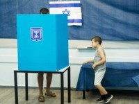 ROSH HAAYIN, ISRAEL - SEPTEMBER 17: An Israeli man and his son casts his vote on September 17, 2019 in Rosh Haayin, Israel. Israelis are heading to the polls for a second time this year after Prime Minister Benjamin Netanyahu failed to form a coalition. (Photo by Amir Levy/Getty Images)