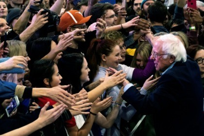 Democratic presidential candidate Vermont Senator Bernie Sanders greets supporters after a campaign rally in Denver, Colorado on February 16, 2020