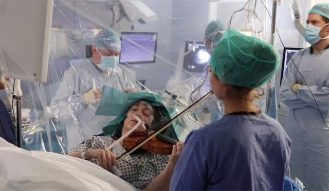 Patient plays violin while getting tumour removed from brain