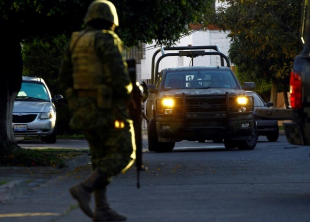 Mexican soldiers pictured taking part in a military operation in January 2014 during which Ruben Oseguera Gonzalez was arrested
