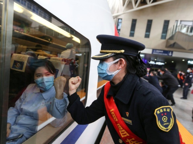 "World Health Organization - This photo taken on February 13, 2020 shows a train attendant gesturing to medical staff leaving for Wuhan in Nanchang, China's central Jiangxi province. - The death toll from the COVID-19 coronavirus epidemic neared 1,400 on February 14, as the United States complained of a ""lack …"