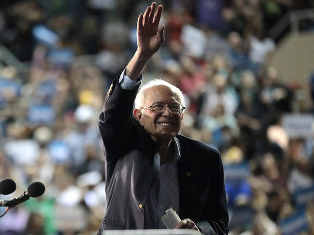 U.S. Senator Bernie Sanders waves to supporters at a campaign rally at Arizona Veterans Memorial Coliseum in Phoenix, Arizona.
