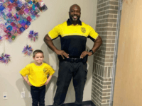 """Check this out! 💛🖤. Today is """"Dress As Your Favorite Person Day"""" at Lester Elementary. Kindergarten scholar Easton dressed as Officer Cross, his favorite school security officer. 🖤💛 #JNPTitans #BuildingFutures"""