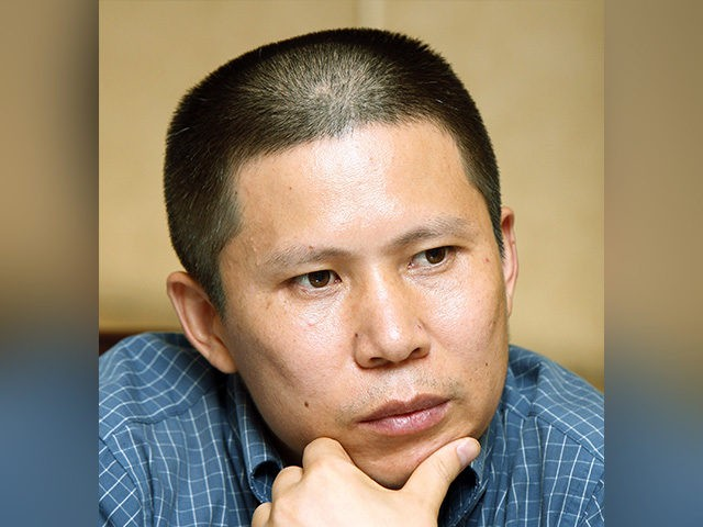 FILE - In this July 17, 2009 file photo, legal scholar Xu Zhiyong, is seen at a meeting in Beijing, China. Xu, an activist Chinese lawyer who was detained in a possible crackdown on dissent ahead of October's 60th anniversary of Communist rule was released Sunday, Aug. 23, 2009, but …