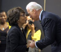 Vice President Joe Biden talks with Rep. Maxine Waters, D-Calif., before speaking in the South Court Auditorium at the White House in Washington, Friday, Nov. 19, 2010, about helping families secure legal help, during a middle class task force even. (AP Photo/Susan Walsh)